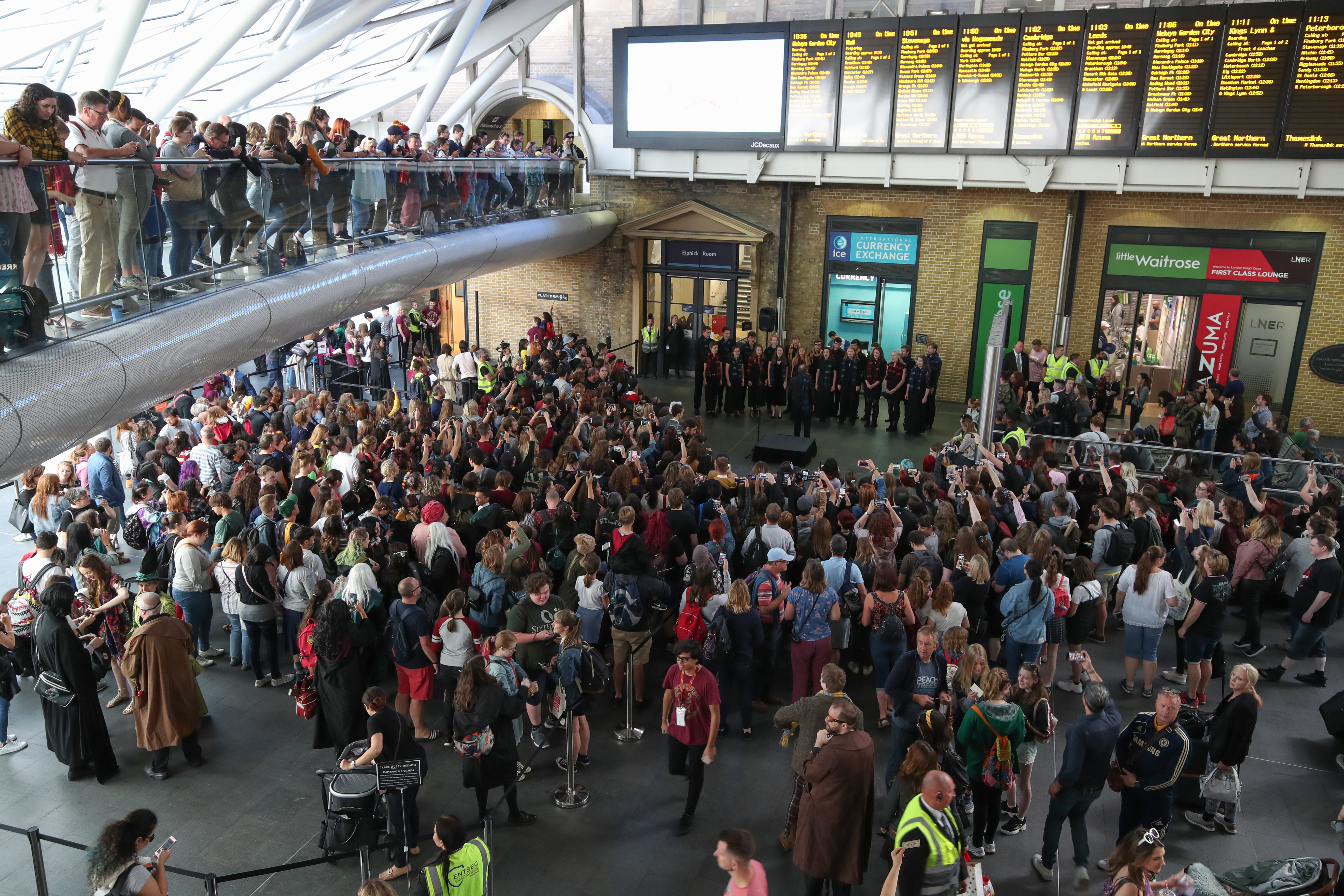 Choir at King's Cross Station for Hogwarts Day