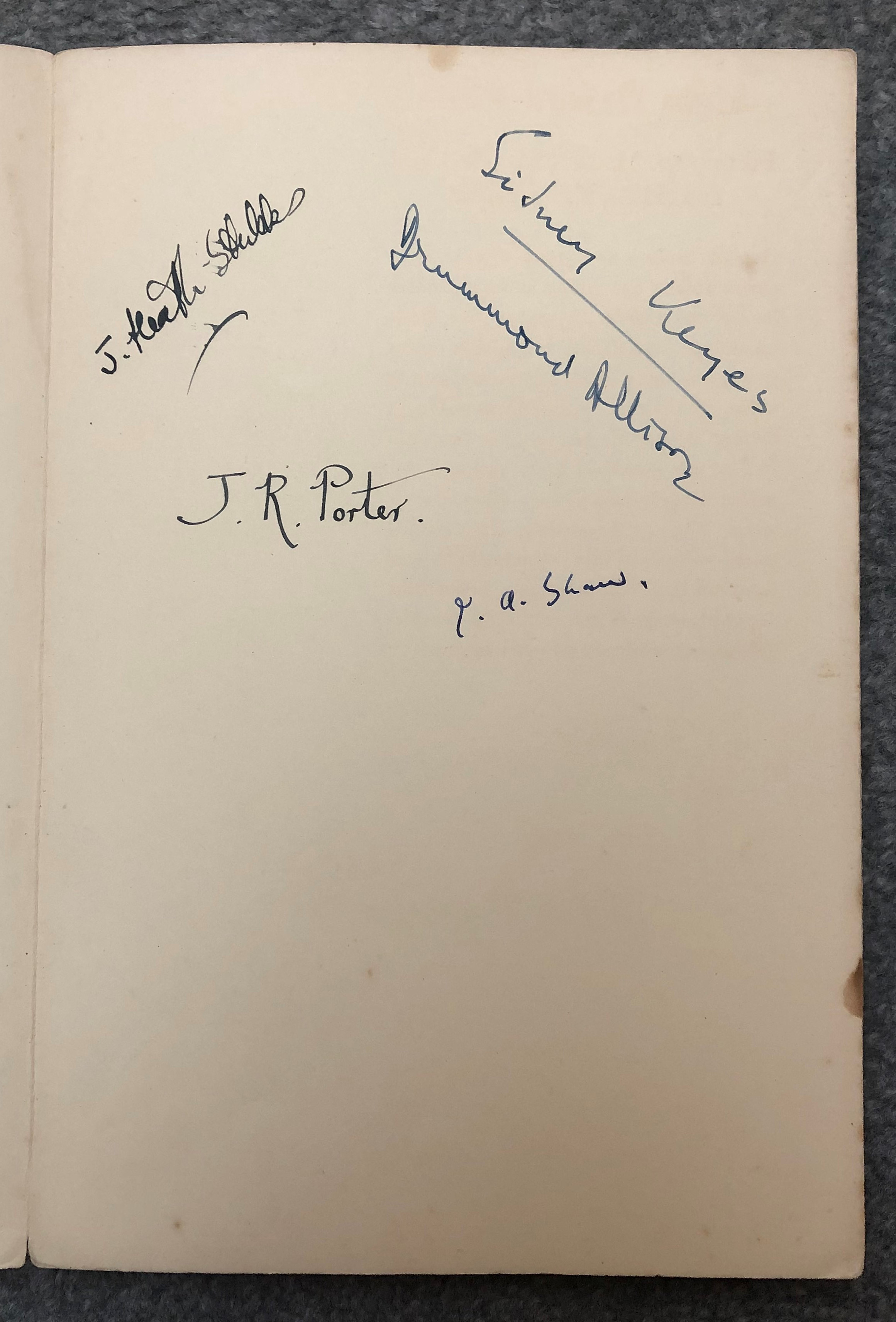 image shows a page of a book bearing signatures