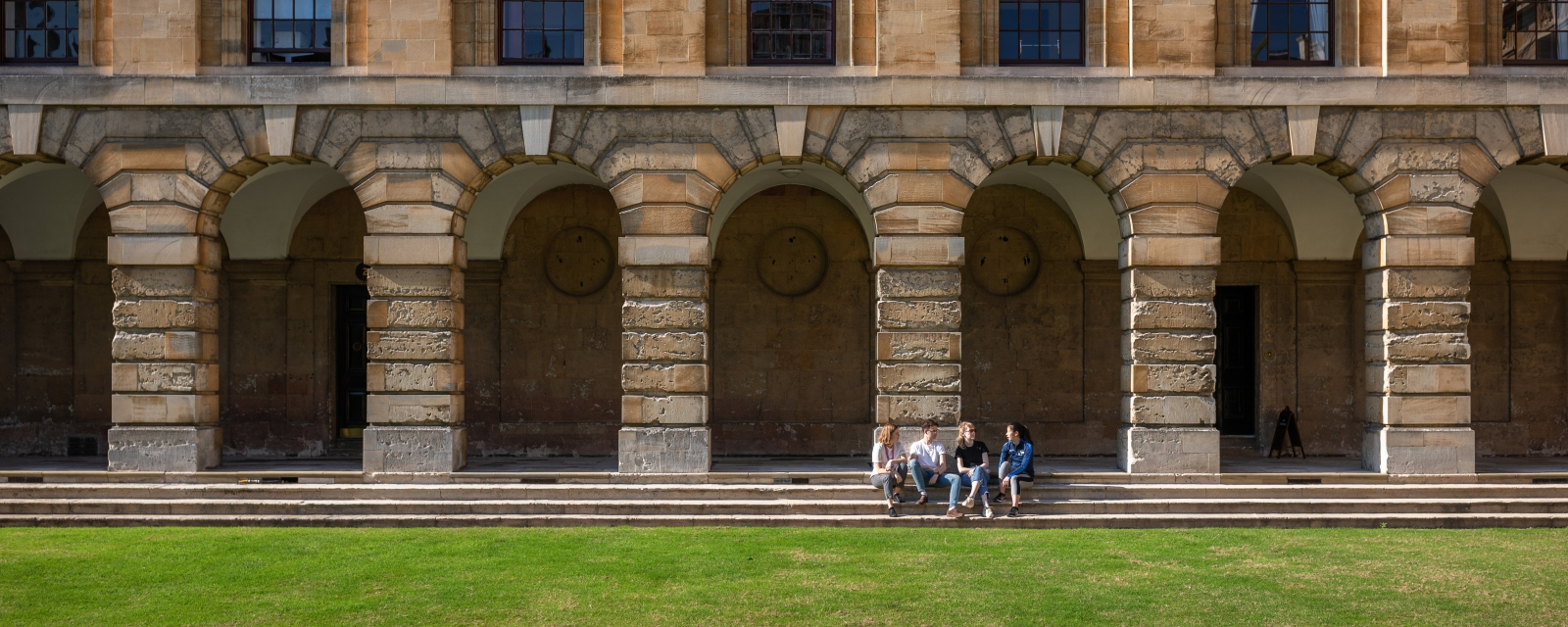 students sitting in the cloisters