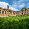 Front Quad at Queen's College with grass in the foreground