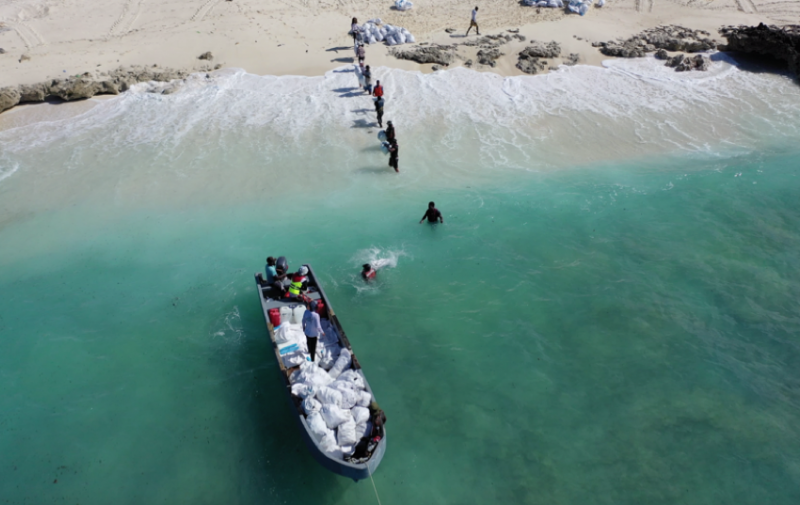 Aldabra removal of trash to boat
