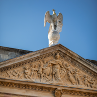 The eagle on the top of the library at The Queen's College