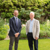 Prof Seth Whidden and Prof Roger Pearson standing together in the Provost's gardens